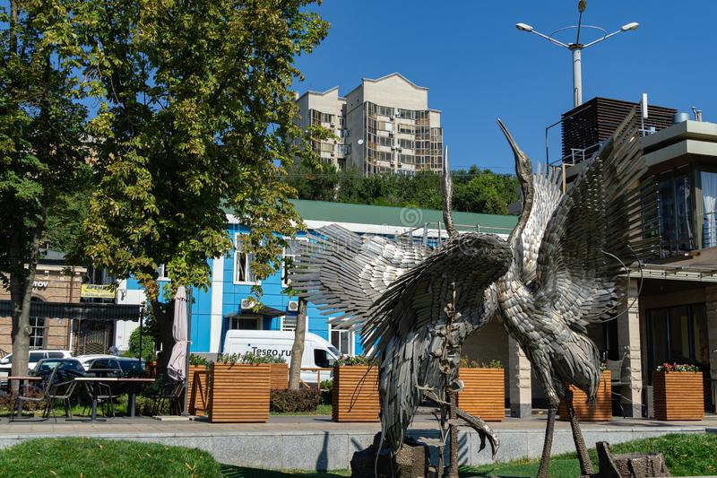 Metal statue of two dancing cranes on embankment of Rostov-on-Don royalty free stock photo