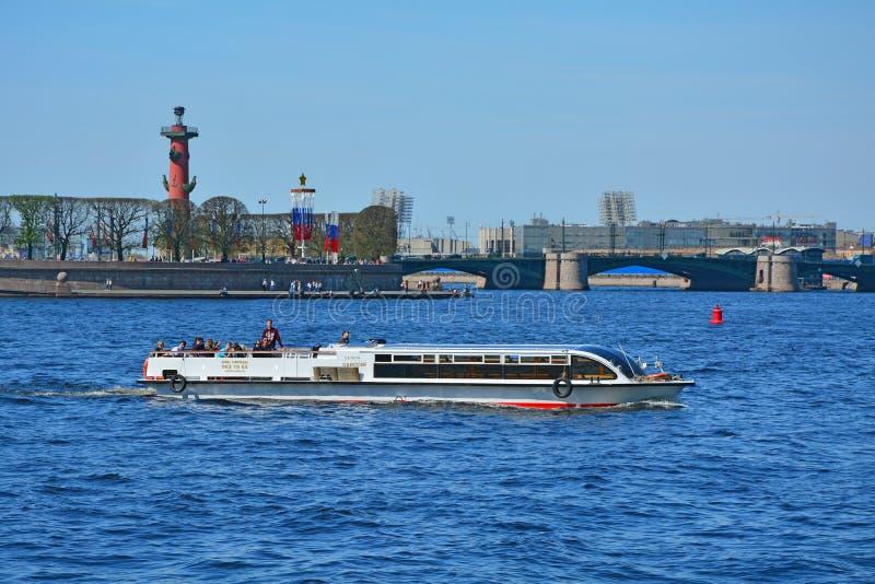 Rostral column and Birjevoy bridge in St. Petersburg, Russia royalty free stock images