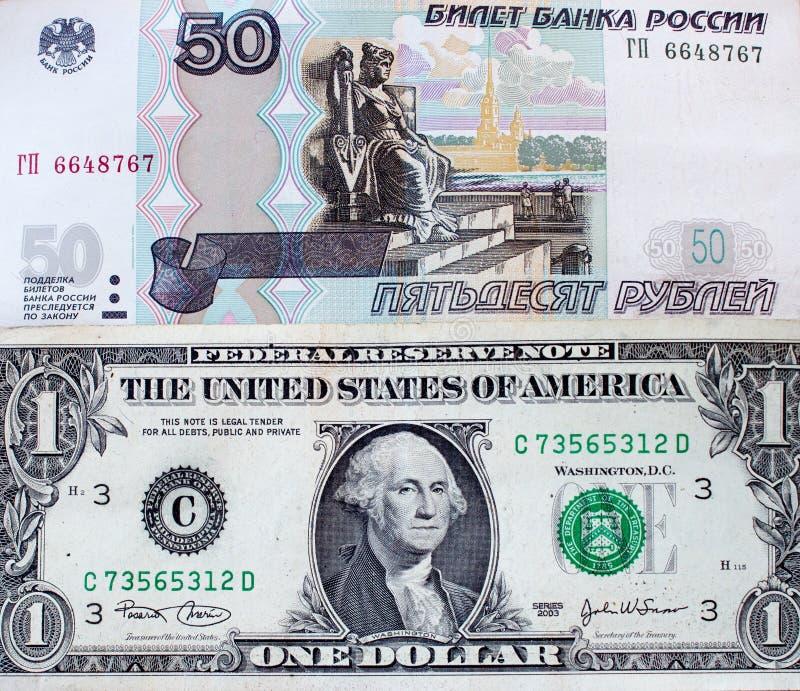 Rosyjscy ruble i dolar amerykański - banknot zdjęcie royalty free