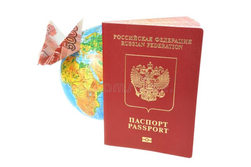 Rosyjski Międzynarodowy paszport, kula ziemska i origami samolot robić dla, obrazy stock