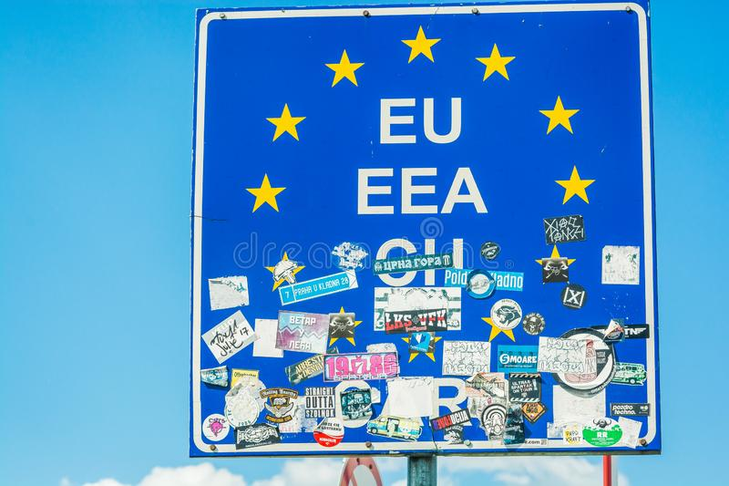 Roszke, Hungary - May 27, 2017. Signboard of EU in border with travel stickers.  stock photo