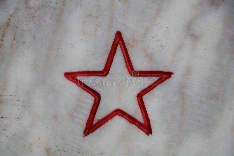 Rot angrenzender Stern stockfotografie