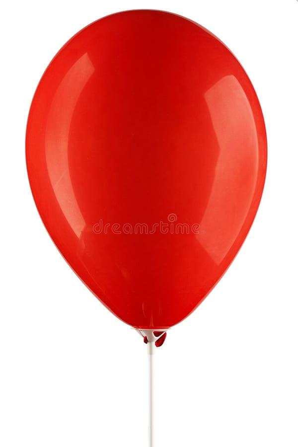 Rot aufgeblähter Luftballon lizenzfreie stockbilder