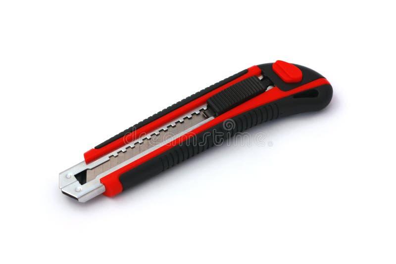 Rot-schwarzes Kastenmesser getrennt auf Weiß stockfoto