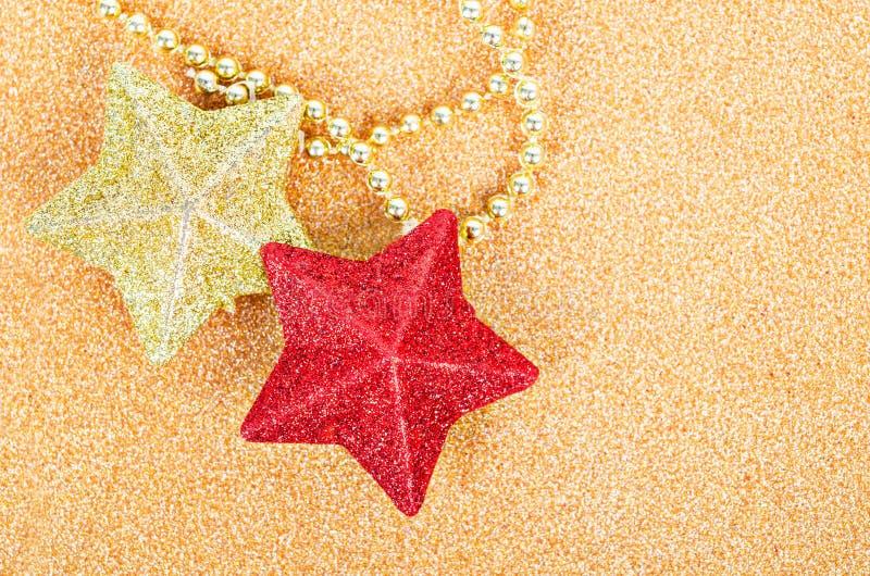 Rot und Gold spielen gliter Dekoration für Weihnachten die Hauptrolle stockbilder