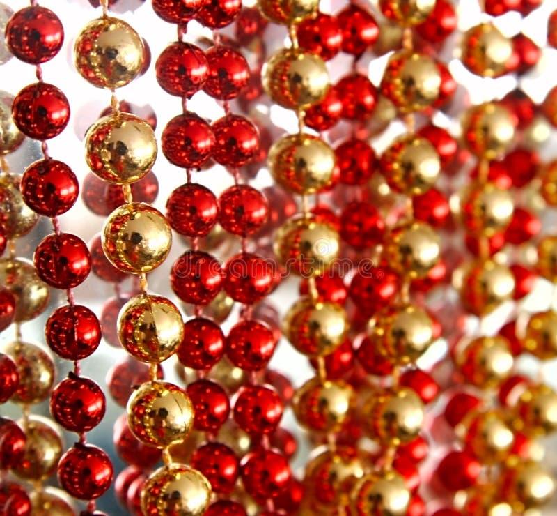Rot und Golddekoration stockbild