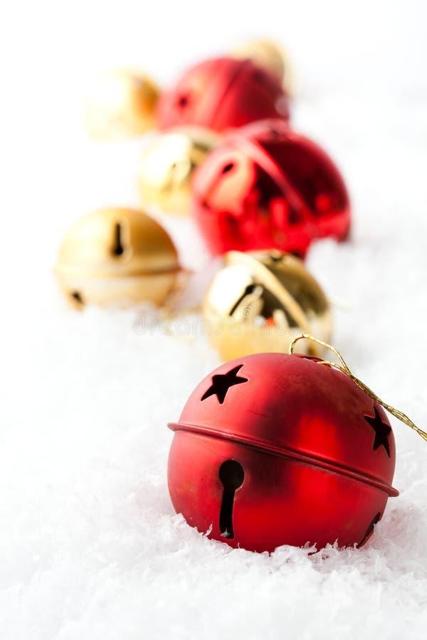 Rot und Goldweihnachtsflitter lizenzfreie stockbilder