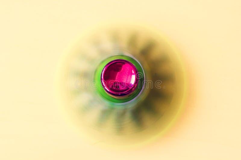 Rotación del hilandero rojo y verde fotografía de archivo libre de regalías