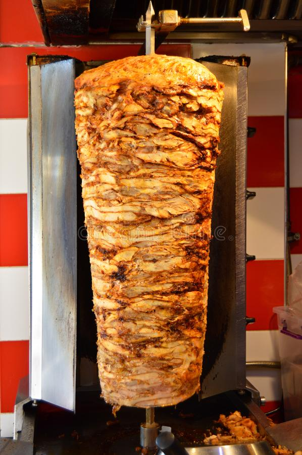 Rotary cooked Turkish chicken doner kebab. Delicious dishes of Turkish cuisine doner kebab. Rotary cooked stock image