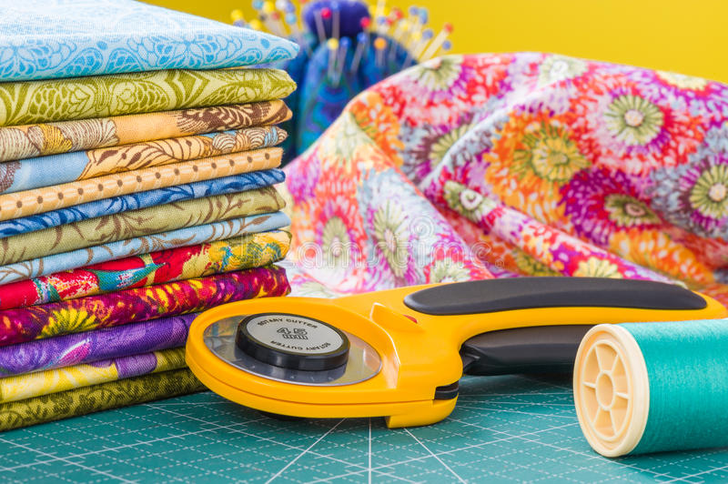 Rotary cutter and spool of thread royalty free stock photography