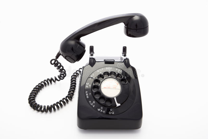 A rotary dial telephone. In black stock photography