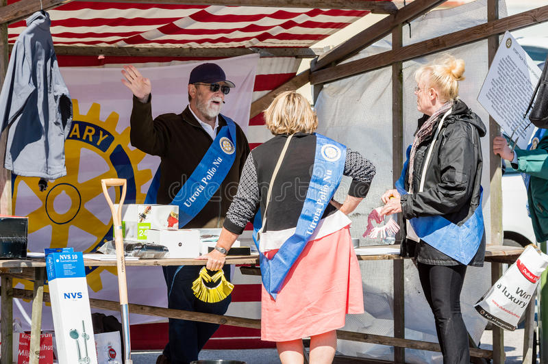 Rotary having lottery. RONNEBY, SWEDEN - JUNE 14, 2014: Sillarodden, a local event with competing teams of fish mongers. Rotary members having a lottery. Banner stock photos