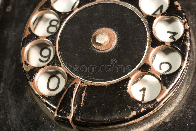 Rotary telephone. Closeup of a black antique rotary telephone stock photo