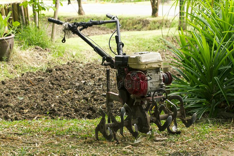 Rotary tiller helps to prepare the soil for modern farmers. stock photo