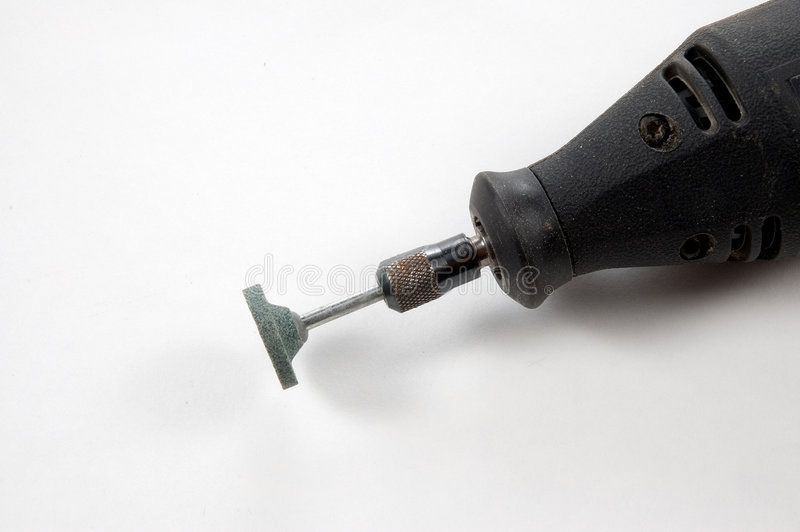 Rotary tool with grinding stone mounted. A rotary tool with a grinding stone attached, photographed on a white background stock images