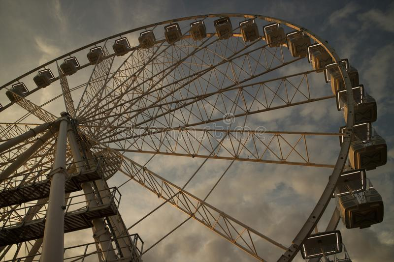 It rotates at the end of the day panning. The great wheel photographed panning pours the end day in the city of Viareggio Italia stock image