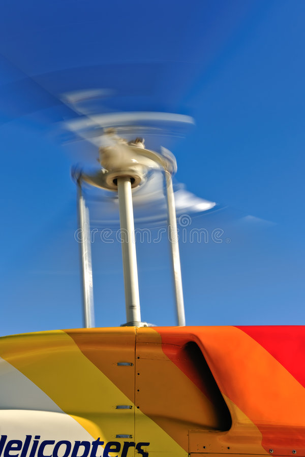 Rotating Chopper Blades. A closeup view of the rotating blades of a Bell 206 Jet Ranger helicopter royalty free stock photo