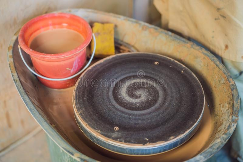Rotating disc for pottery in a pottery workshop.  royalty free stock images