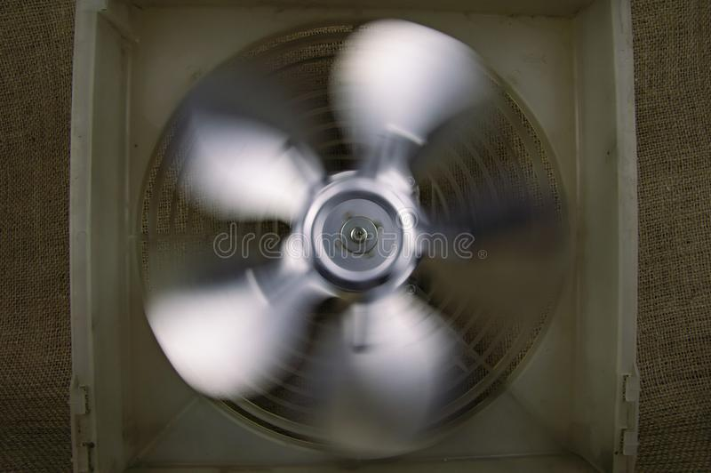Rotating fan blowing cooling system - repair of refrigerators royalty free stock photography