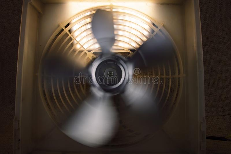 Rotating fan blowing cooling system - repair of refrigerators stock images