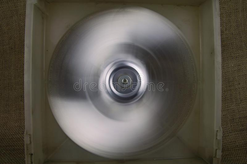 Rotating fan blowing cooling system - repair of refrigerators royalty free stock photo