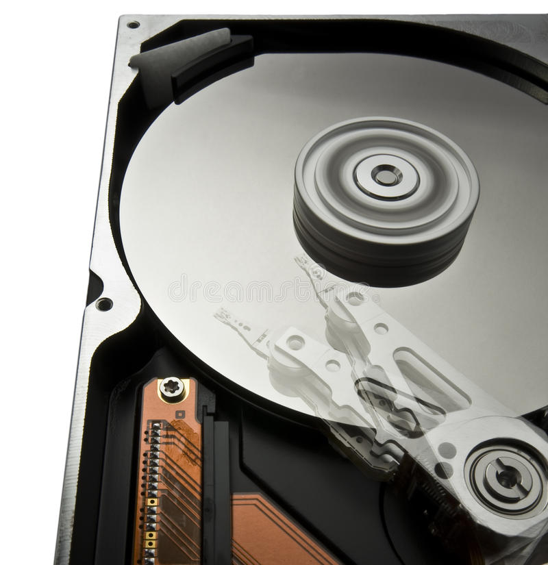 Rotating hard disk with moving head royalty free stock photo