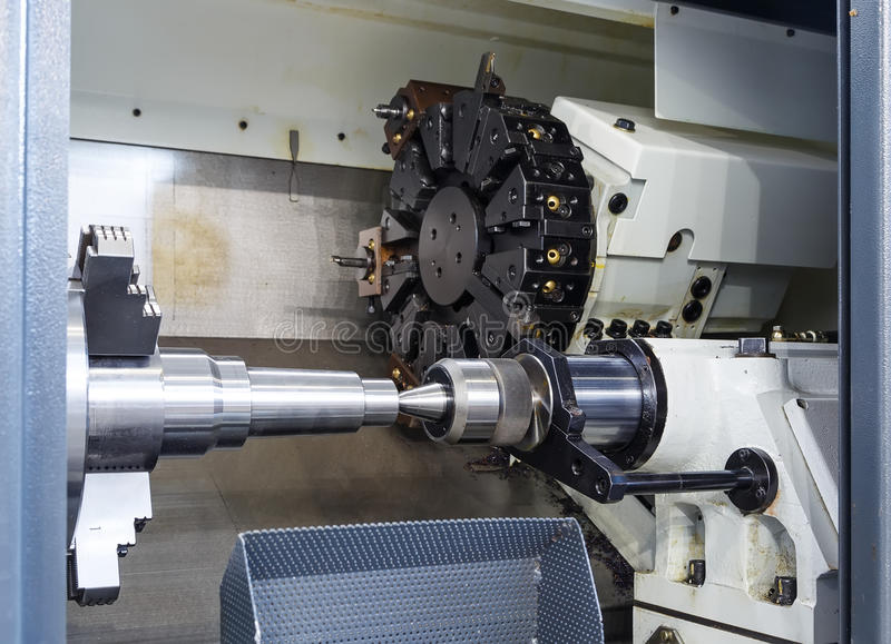 Rotating head with drilling machine bits and tools in a high precision mechanics plant at CNC lathe in workshop stock images