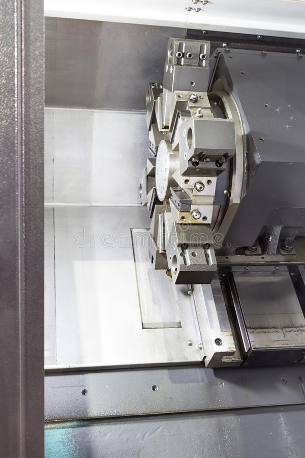 Rotating head in a high precision mechanics plant at CNC lathe stock photo