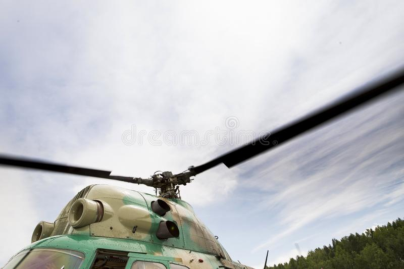 Rotating helicopter propeller blades stock photography