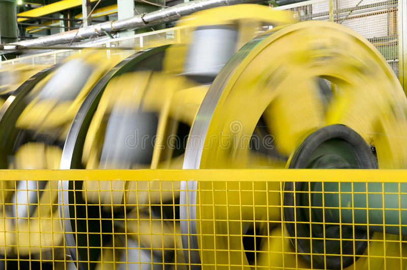Rotating machines. Rotating machinery in a factory producing electrical cable stock image