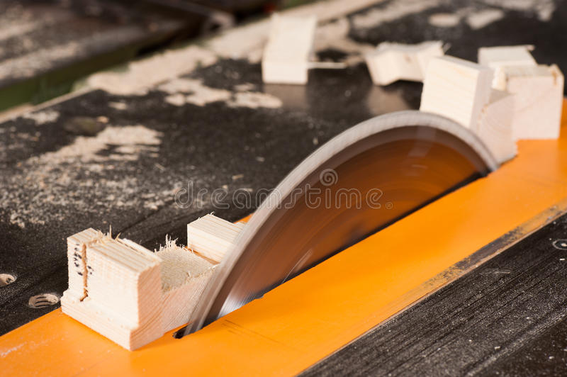 Rotating table saw. Rotating blade of a circular table saw royalty free stock images