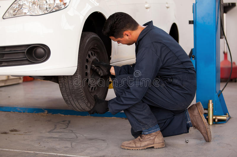 Download Rotating Tires At An Auto Shop Stock Photo - Image: 33750300