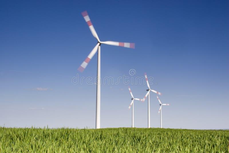 Rotating wind-turbines stock photo