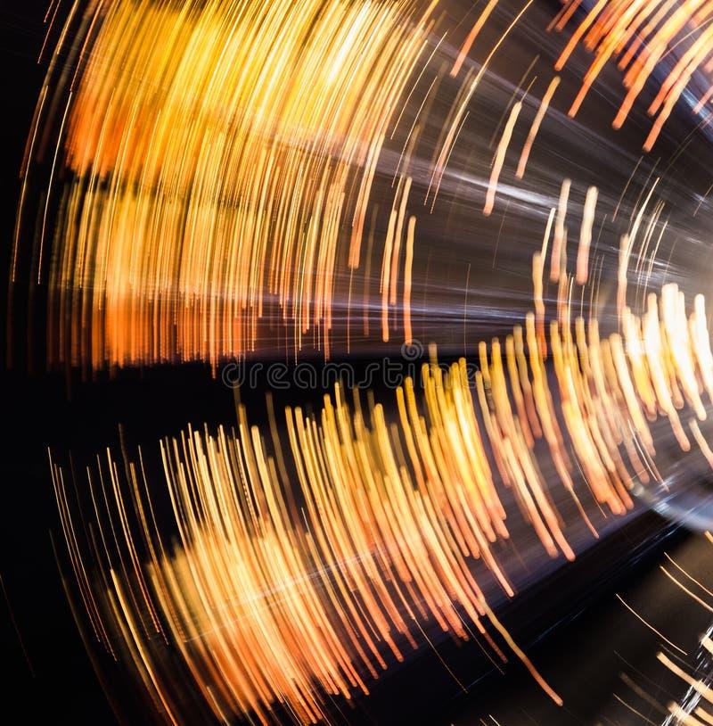 Rotation de la tache floue légère circulaire jaune et noire images libres de droits