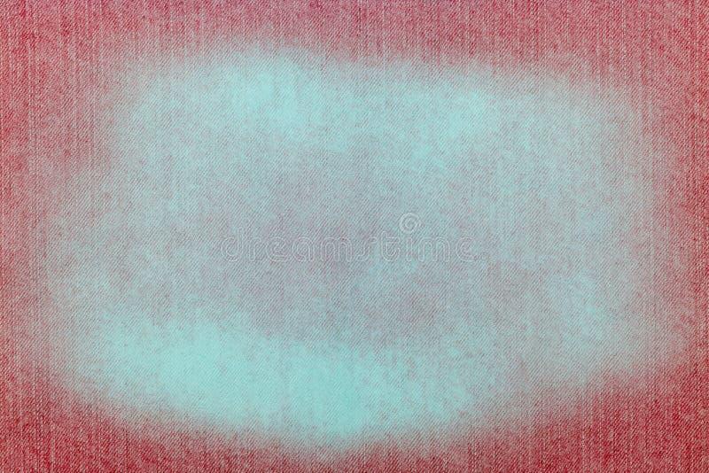 Rote Beschaffenheit des Jeansgewebes mit weißem schäbigem Fleck lizenzfreies stockbild