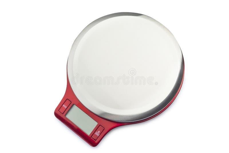 Rote elektronische Gewichts-Skala auf weißem Hintergrund stockbild
