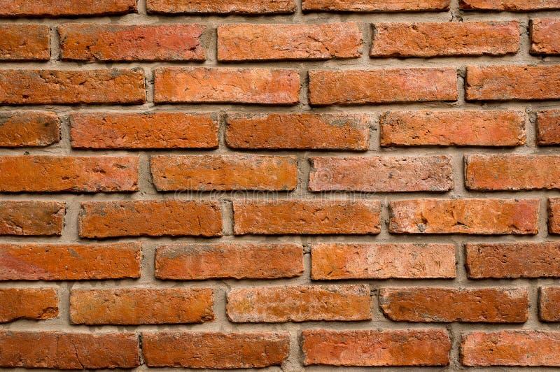 Rote Farbe der Backsteinmauer, Beschaffenheitshintergrund, altes Braun stockfotografie