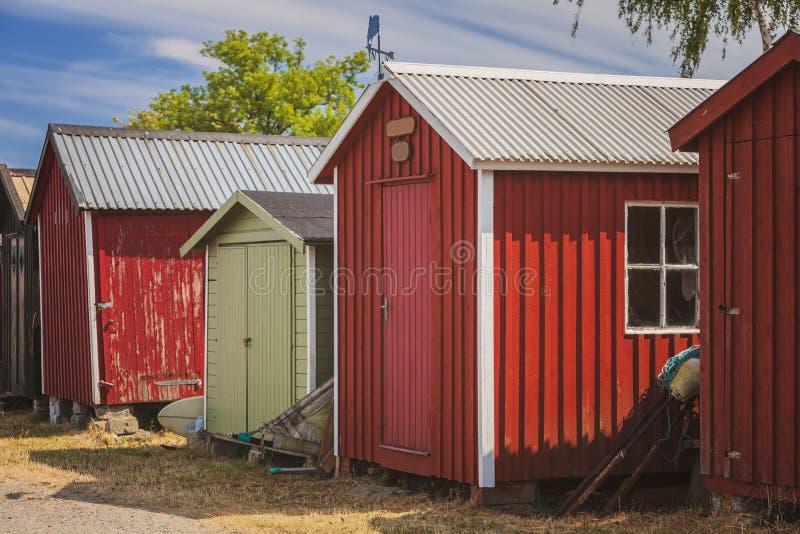 Rote Fischenhütten stockfotos