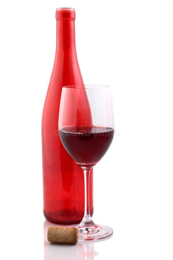 Rote Flasche und Rotwein lizenzfreie stockfotos