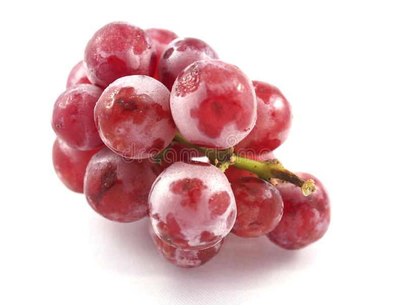 Rote Frucht der Traube auf Hintergrundweiß lizenzfreie stockbilder