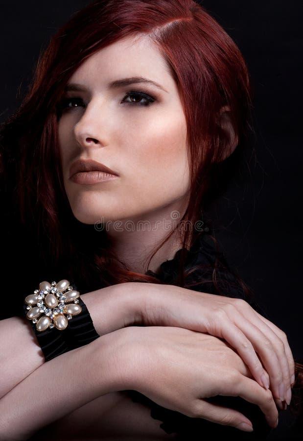 Rote Haarschönheit stockfoto