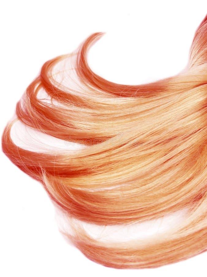 Rote Haarstränge stockfotos