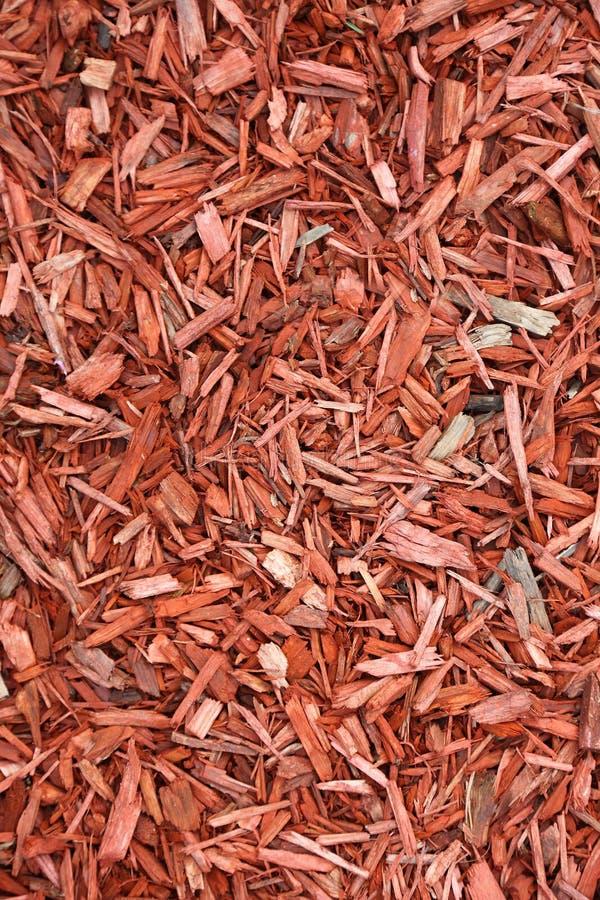 Rote Holzspäne als Hintergrund. stockbild