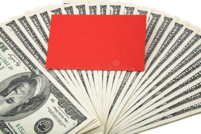 Rote leere Karte auf einer Verbreitung des Bargeldes stockfotos