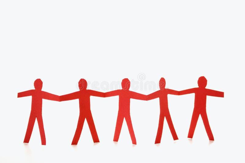 Rote Leuteholdinghände stockfoto