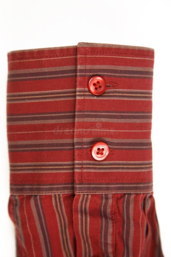 Rote Manschette von gestreiftem Hemd lizenzfreie stockfotos
