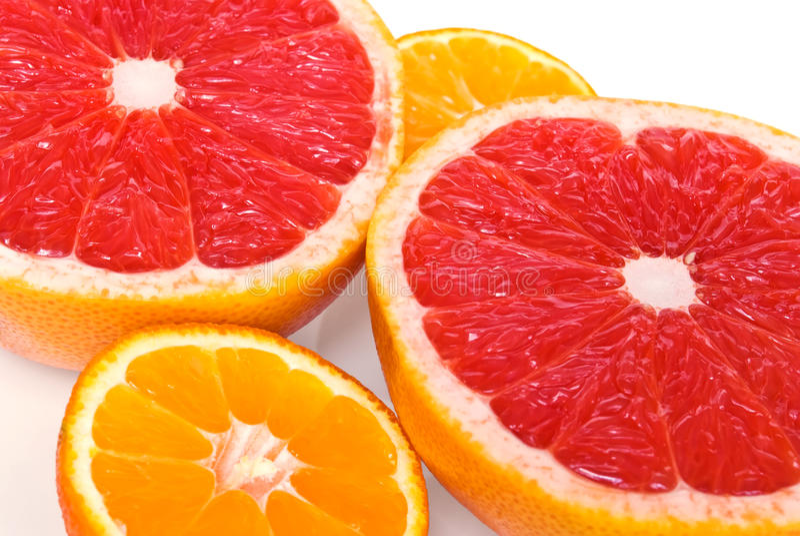 Rote Pampelmusen und Mandarinen stockfotografie