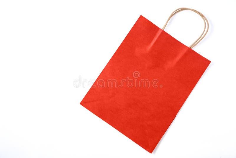 Rote Papiert?te auf wei?em Hintergrund Beschneidungspfad eingeschlossen stockbild
