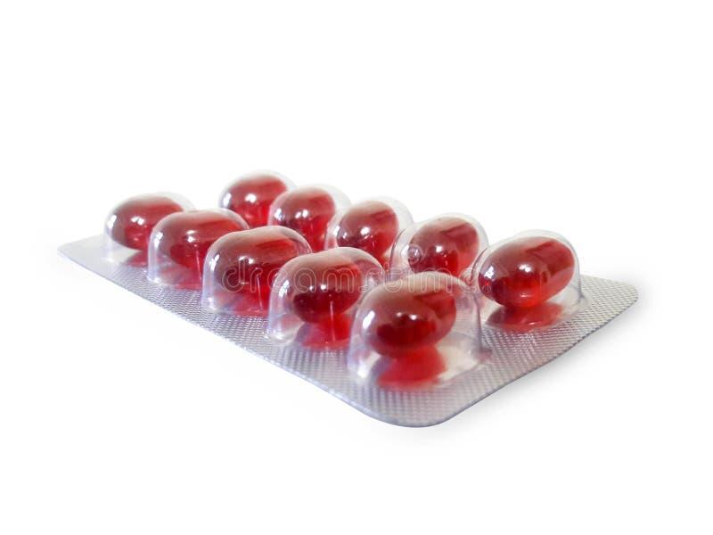 Rote Pille im Satz stockbilder
