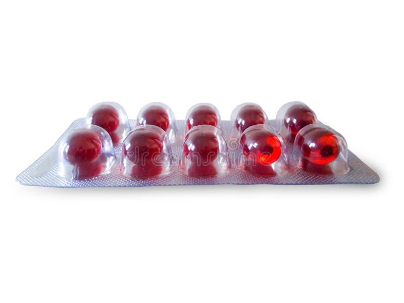 Rote Pille im Satz lizenzfreie stockfotografie